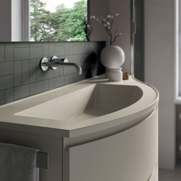 Curved bathroom cabinets with round edged Mineralsolid tops, glossy or matt to match the fronts.